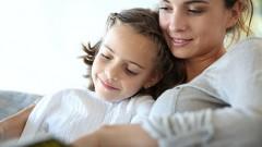 bigstock-Mom-with-little-girl-reading-b-53339449